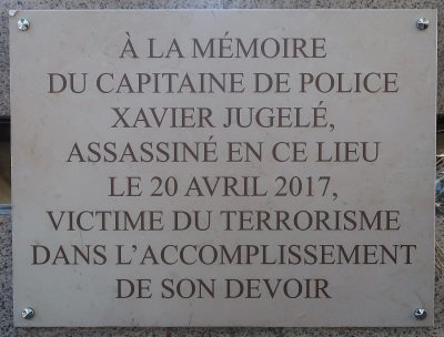 From Wikimedia Commons, the free media repository  Plaque en hommage à Xavier Jugelé, 102 avenue des Champs-Élysées (Paris, 8e). Date	25 June 2018, 16:35:00 Source	Own work Author	Celette